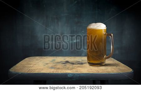 Beer barrel with glasses on table wooden background.