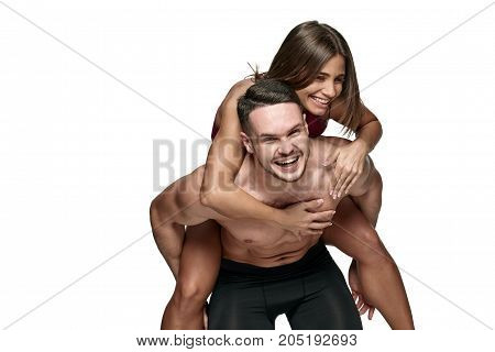Portrait of happy sporty athletes having fun and laughing, with copy cpace