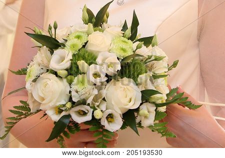 beautiful wedding bouquet in the hand of the bride