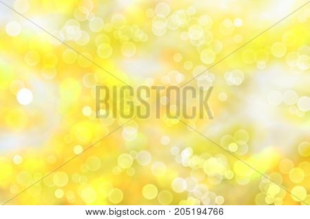 autumn blurred background of yellow leaves with bokeh effect