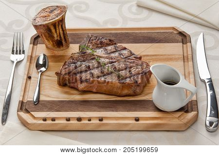 Grilled Meat On The Board With Sauce