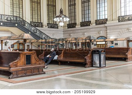 Hoboken NJ USA -- September 19 2017 The waiting room for the Hobaoken train station. A man is alseep on one of the benches. Editorial Use Only.