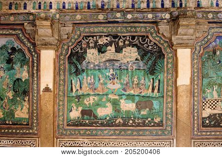 India detail of the decorated wall in the palace in the Bundi city in Rajasthan
