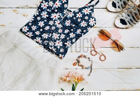 Fashion Summer girl clothes Set Accessories. summer Outfit. Stylish Floral Dress Trendy fashion Sunglasses flowers. Glamor Gumshoes. Summer lady Essentials. Creative Design. Fashion Urban Concept