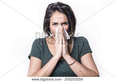 A sneeze girl having flu on white studo background