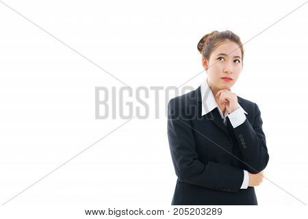 Young Asian businesswoman wearing in black suit and white t-shirt crossing her arms and thinking isolated on white background