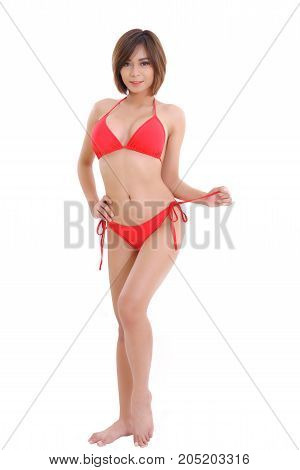 Beautiful young brunette Asian woman wearing red bikini isolated on white background