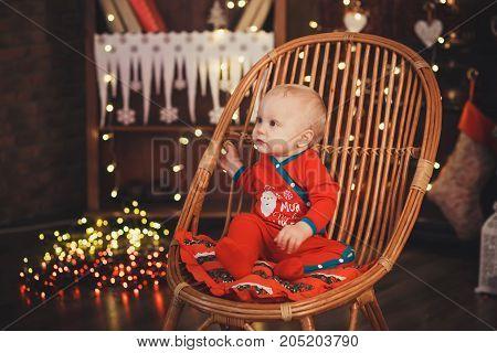 Lovely Baby Boy In Santa Costume For Christmas.