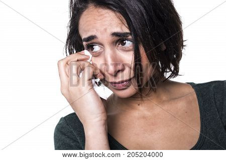 A beautiful young woman breaks out in tears.