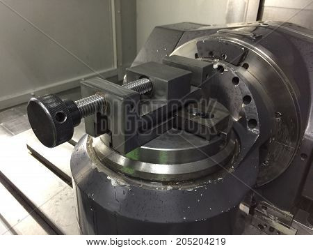 Work clamp in CNC 5 axis machine Close up at Industrial machine