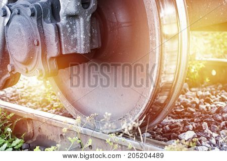 Train wheel on the railway. Rail transport infrutstructure close up