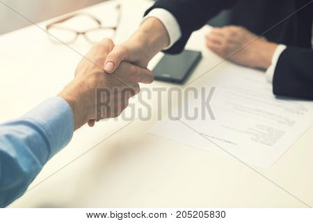 handshake after successful job interview at office