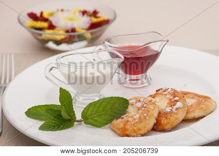 closeup of a breakfast with pancakes and milk