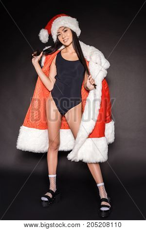 Woman In Santa Robe And Swimsuit