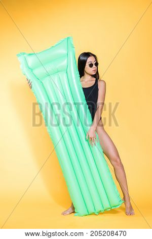 Woman In Swimsuit With Pool Mattress