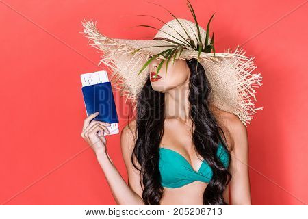 Woman In Swimsuit Holding Tickets