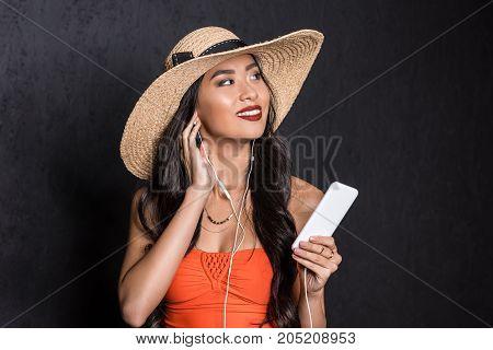 Woman In Beach Attire Listening To Music