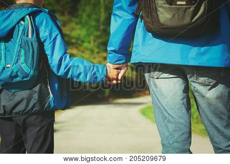 father and son on going to school, parenting concept