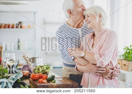 Grandpa Hugs And Kisses Smiling Grandma