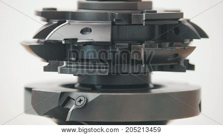 Rotated milling cutter - industrial milling machine cutting metal, close up