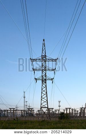 High-voltage towers with sky background at sunset.