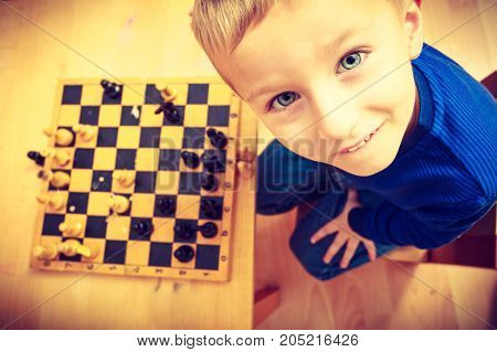 Young Kid Boy Playing Chess Having Fun
