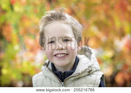 A boy in autumn season in a park