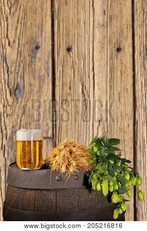 Still Life with Beer and Hops on the Wooden Background