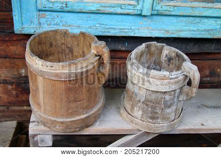 The picture was taken in Ukraine. In one of the villages of the Carpathian Mountains. In the photo there are old wooden mugs used in the past.