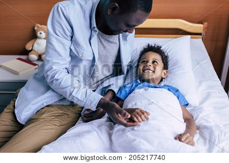 African American Boy Looking At Father