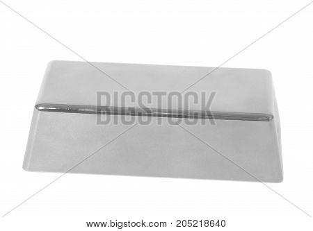 Silver bullion isolated on white background .