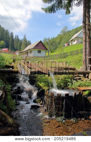 The picture was taken in Ukraine in the Carpathian Mountains. The picture shows the original village vat for washing. The vat is filled with water from a mountain stream in a natural way.
