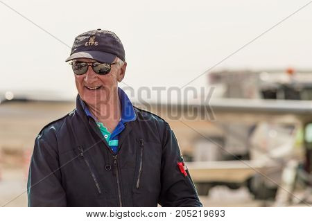 Sivrihisar Eskisehir Turkey - September 17 2017: Sivrihisar Airshows (SHG) small aviation event displayed in SUSHM. Pilot of Boeing Stearman aircraft Bob Pooler greeting the audience.
