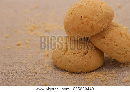 oatmeal cookies light brown with crumbs on the napkin