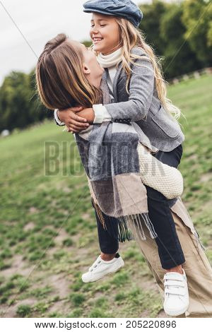 Cheerful Mother And Daughter At Countryside