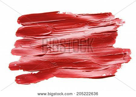Red paint on white background. The relief of smears is visible. Isolated