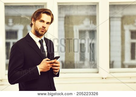 Business, Technology And People Concept, Serious Businessman With Smartphone