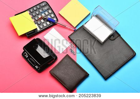 Calculator,  Notebook, Hole Punch, Business Card Holder And Note Paper