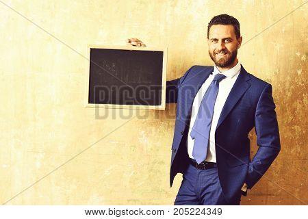 Businessman Or Happy Man Holding A Blackboard