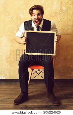Student Or Happy Businessman Holding A Blackboard