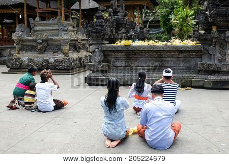 Bali Indonesia - September 9 2017: Unidentified balinese prays at Pura Tirta Empul Hindu temple