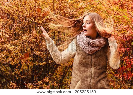 Mystery Woman Against Autumnal Leaves Outdoor