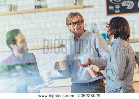 Men Drinking Coffee In Cafe