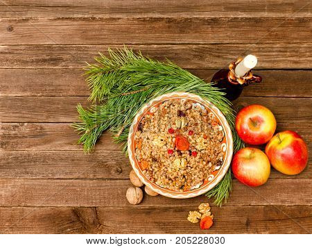 Top View Of A Dish Of Traditional Christmas Dish Slavs Kutia. Wooden Background Spruce Branch, Apple
