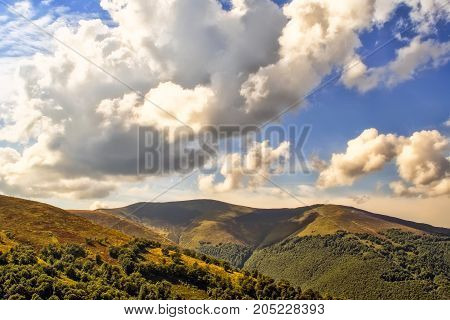 Viewn on the mountains and cumulus clouds. Carpathians Ukraine