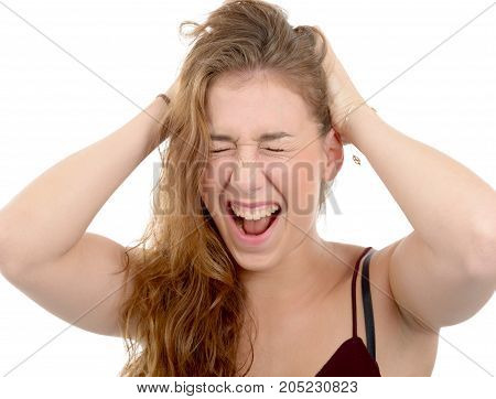 Frustrated woman pulling her hair isolated on white background
