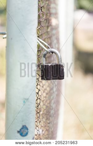 metal lock on the fence . Photo as an abstract background