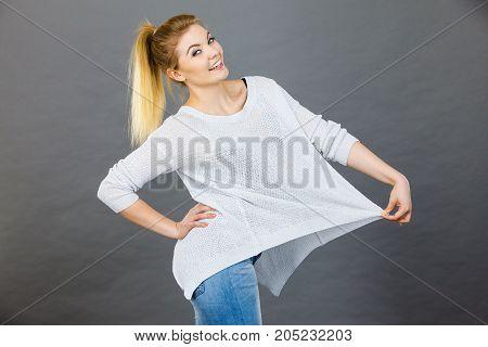 Woman Wearing Too Big Jumper