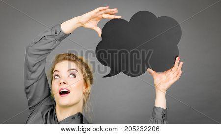 Shocked Woman Holding Black Thinking Bubble