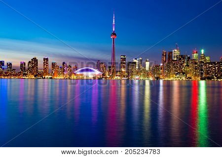 Toronto downtown skyline with lake ontario at sunset